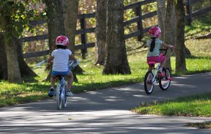 Children biking on greenway
